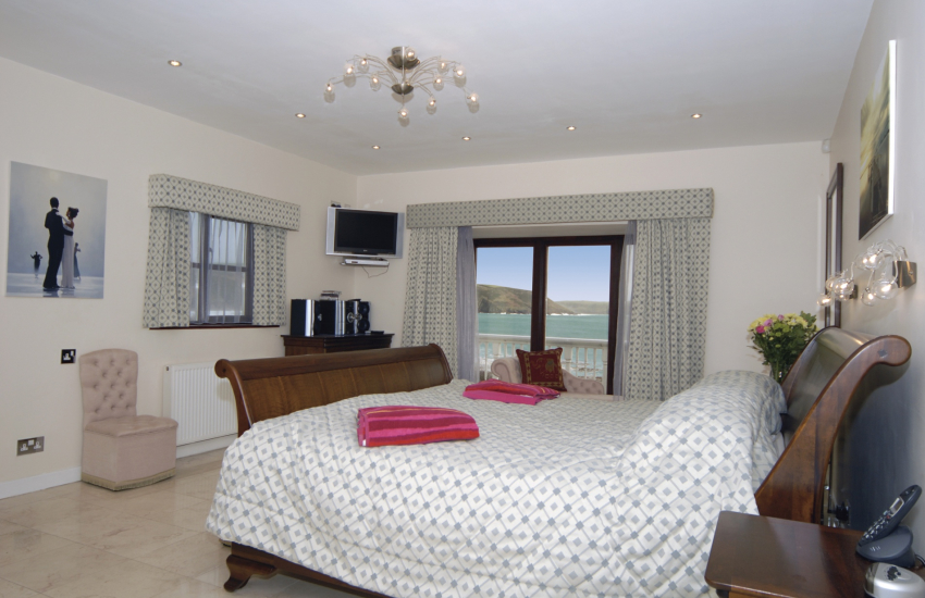 Freshwater East holiday home - bedroom with Smart tvs ,wifi and ambient sounds and sea views