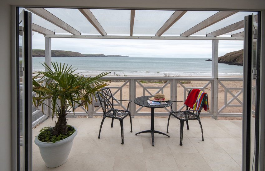 Sandcastle House sleeps 14 - bedroom with verandah and sea views