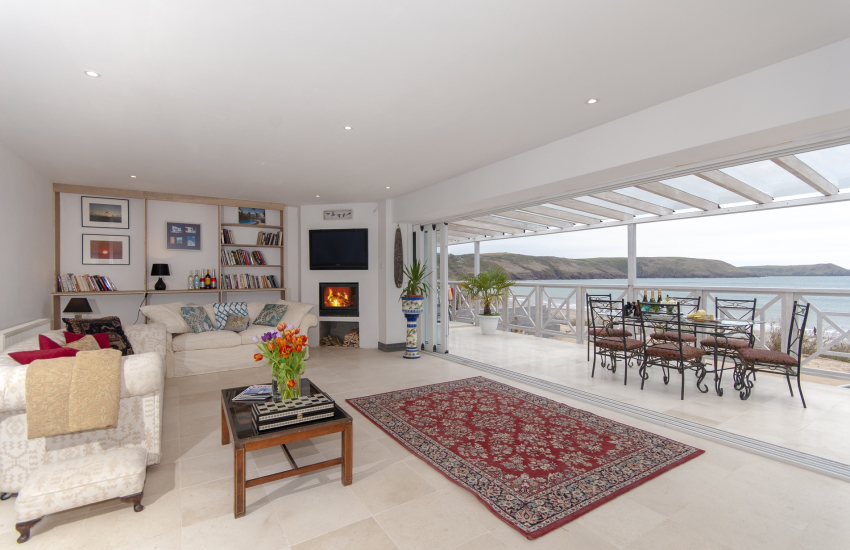 Freshwater East beach side modern holiday home -  40 ft glass fronted lounge with verandah and sea views