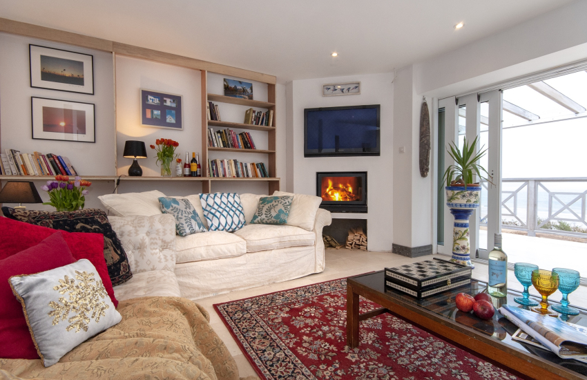 Freshwater holiday home - sitting room with stone floors, underfloor heating and log burner