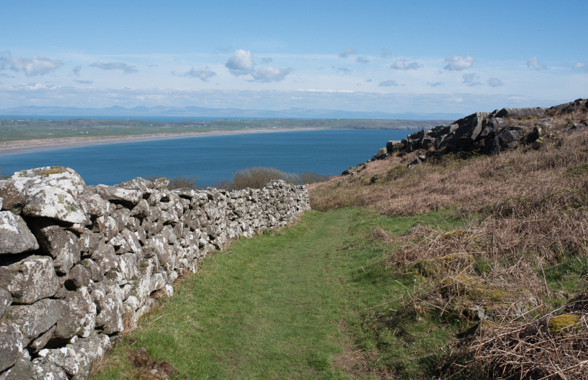 View of Hells Mouth with views across to Cardigan Bay and Snowdonia from footpath
