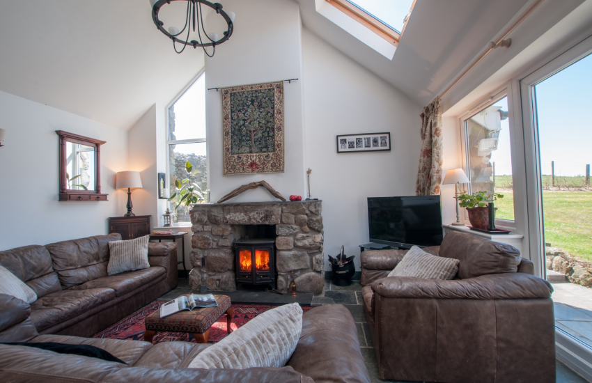 Lounge with French doors to garden with log burner and fabulous views of sunsets