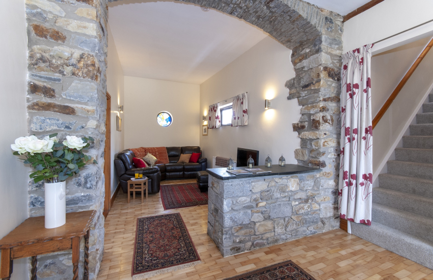 Gower large holiday home - entrance dining hall with cosy snug