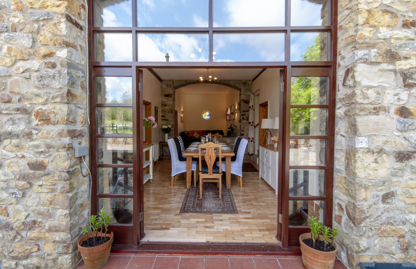 Cae Forgan Barn front doors to the dining area
