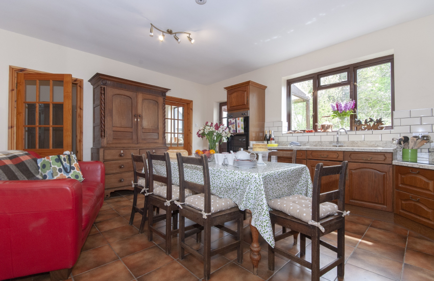 Self-catering, Gower family home - fully equipped kitchen with sofa and table seating for 8