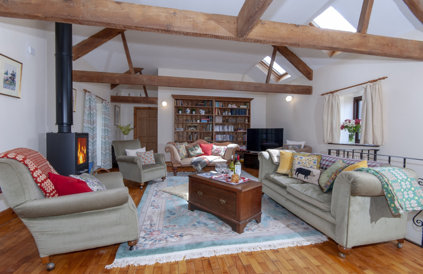 Llangennith holiday home - first floor sitting room with vaulted ceiling, wifi and log burning stove