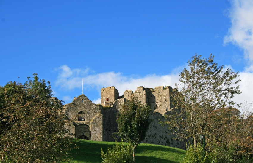 Oystermouth Castle stand as an impressive guardian over Mumbles Village