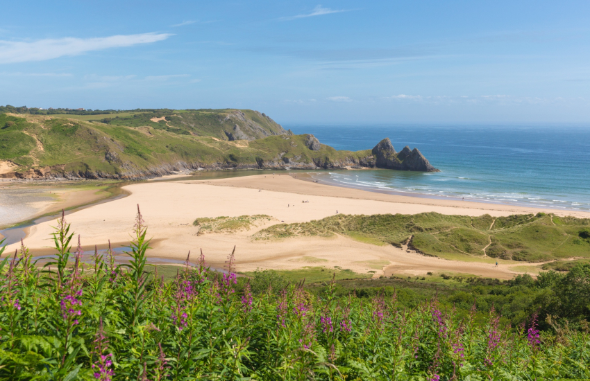 Three Cliffs Bay is vast and sandy with dramatic cliffs
