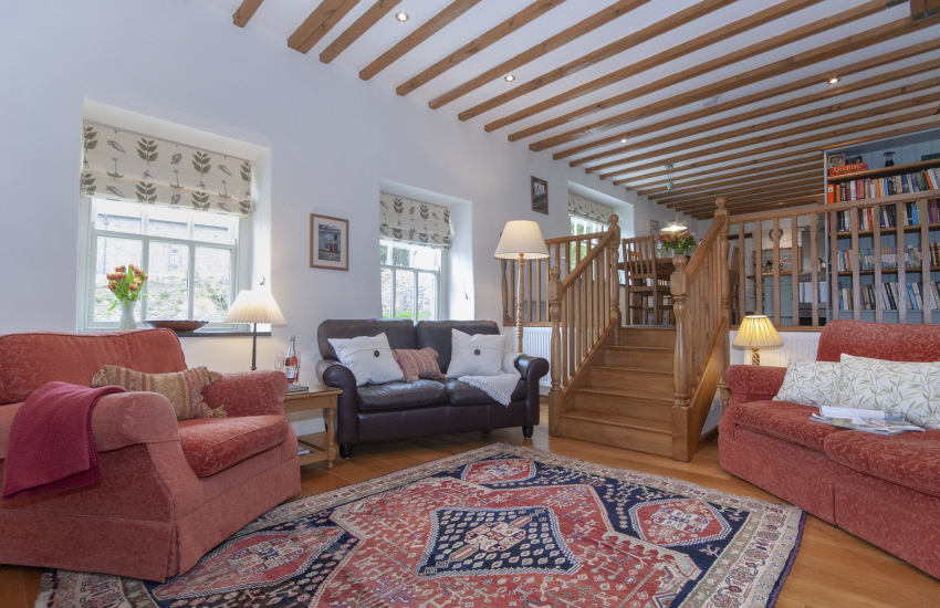 Abercastle luxury holiday cottage open plan sitting room with stairs to kitchen/diner