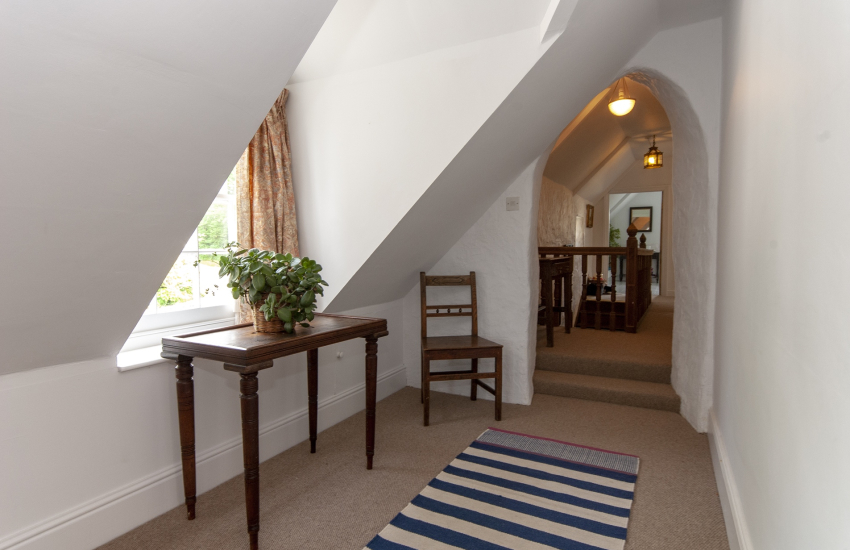 18th Century holiday house near Creswell Quay - first floor landing with original stone carved archway