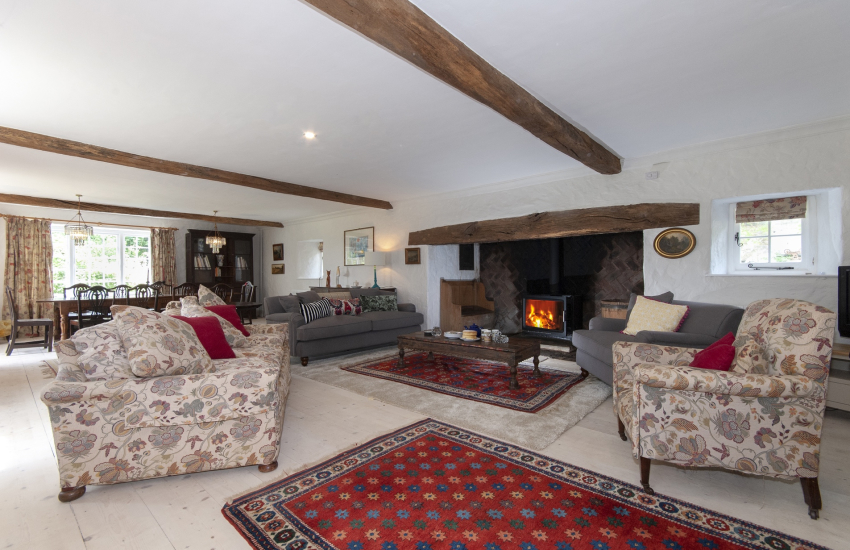 South Pembrokeshire holiday home -  spacious open plan sitting/dining room with large Inglenook fireplace and wood burning stove