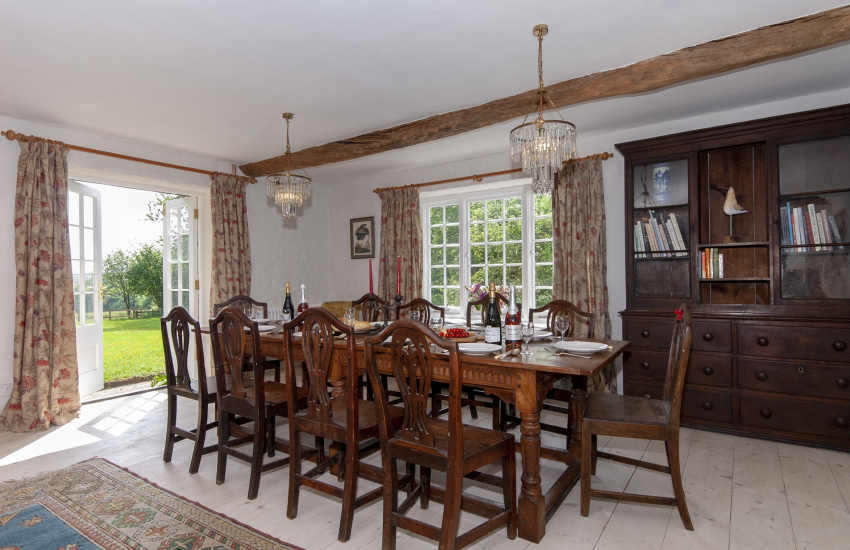 South Pembrokeshire family home with a mix of antique furniture - living/dining room with french doors to the gardens
