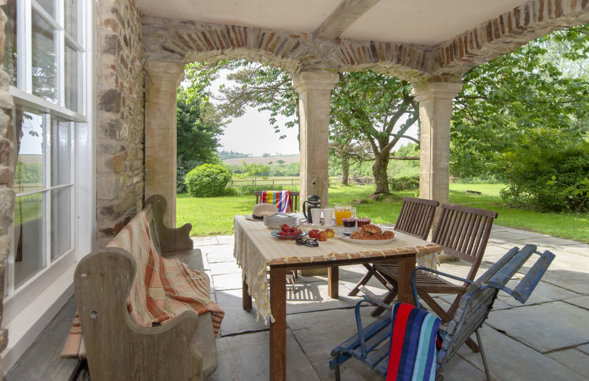 Dine Alfresco between the stone arched patio over looking the gardens