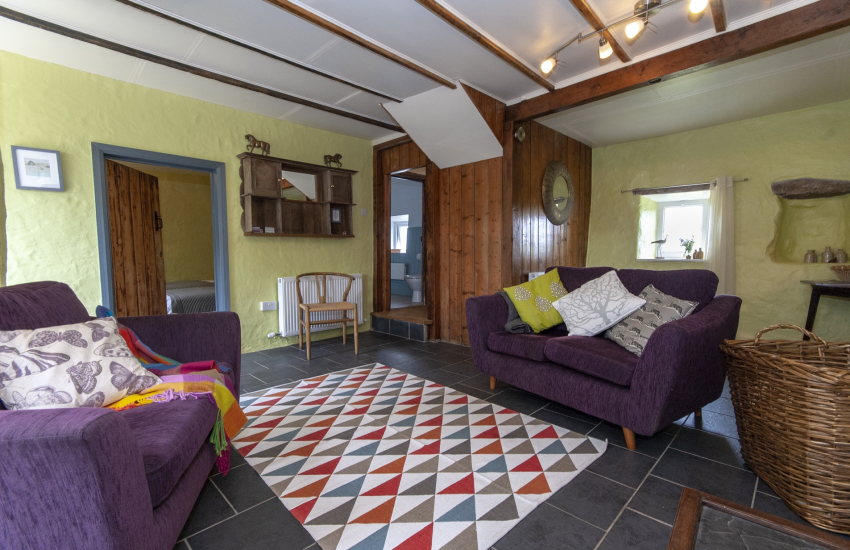 Newgale Sands holiday cottage - living room with unlimited wifi and wood burning stove