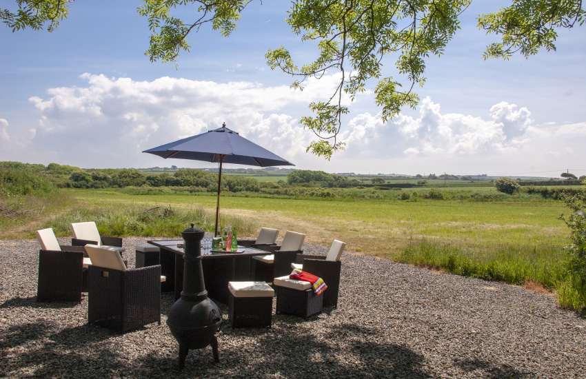 St Davids holiday barn - gardens with rattan furniture and countryside views