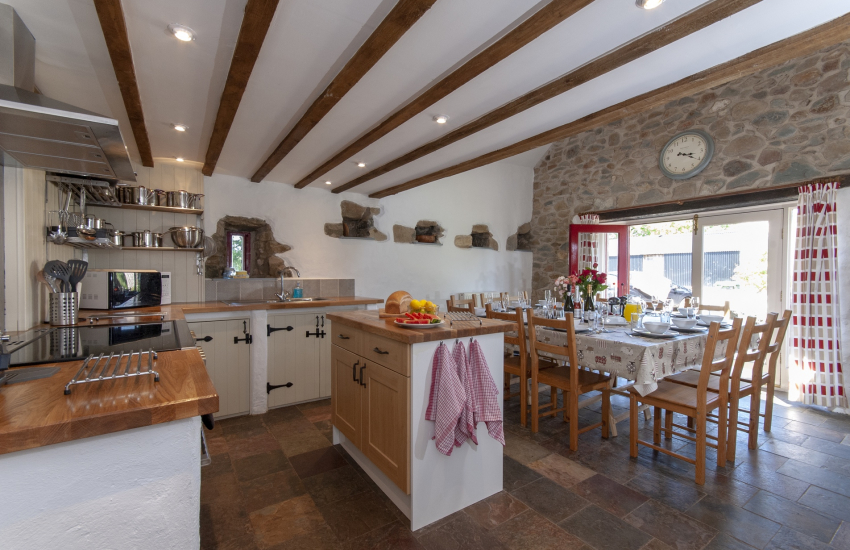 North Pembrokeshire stone barn conversion - farmhouse style kitchen/diner with seating for 12 guests
