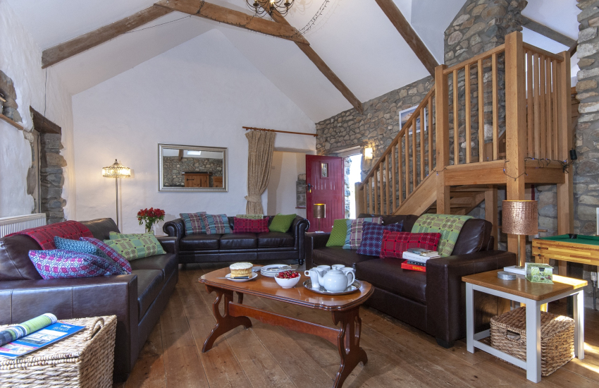 Solva  luxury holiday barn - spacious sitting room with Oak staircase to twin bedroom