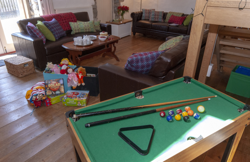 Mini pool table, puppets, dolls and plenty of family games at Ty Dewi Barn