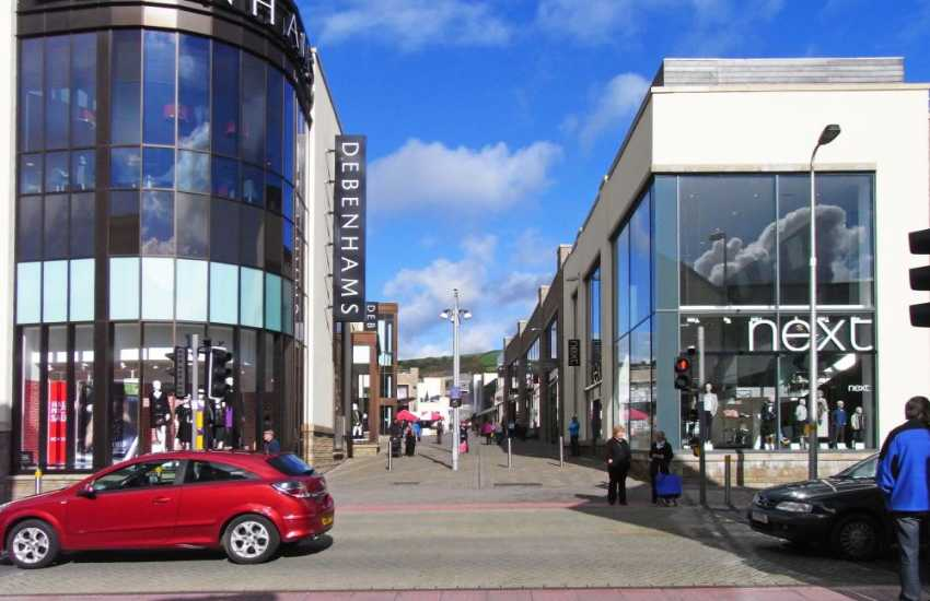 Carmarthen county town has a traditional market selling local produce, department stores, museum, cinema and Leisure Centre with a 25m swimming pool and Health Suite with sauna, spa pool and steam room