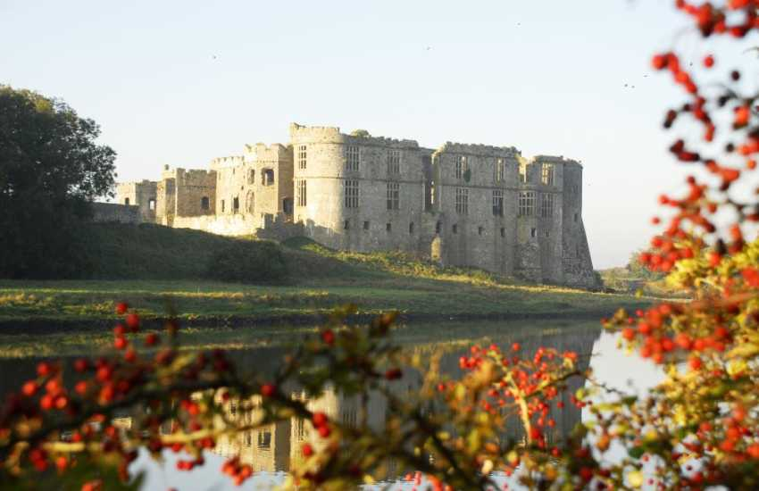 The magnificent ruins of Carew Castle in a stunning setting overlooking a 23-acre millpond