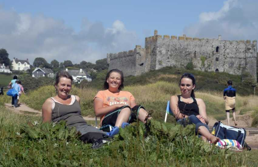 Medieval Manorbier Castle overlooks the beach - popular with families, surfers and great for rock-pooling