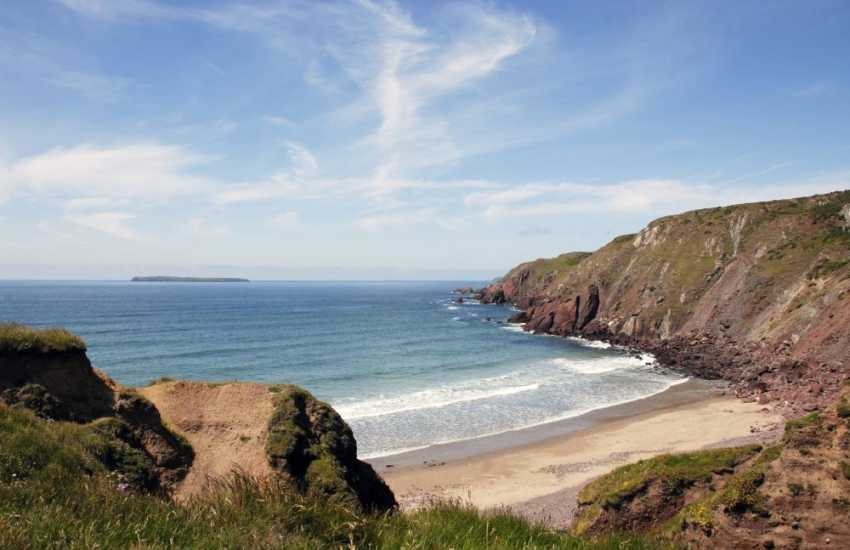 West Dale is a sandy beach enclosed by towering cliffs accessible only by steep steps