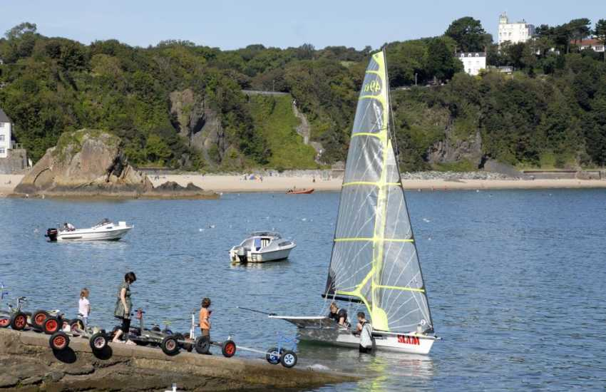 Try your hand at sailing from the slipway nearby
