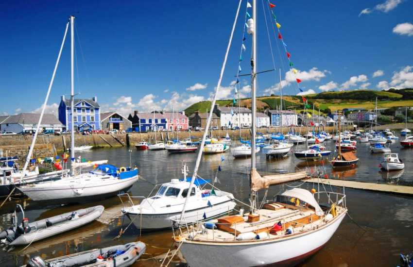The picturesque walled harbour in Aberaeron is overlooked by Quay Parade and the award-winning Harbour master Hotel