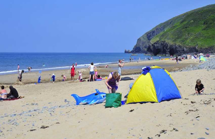 Penbryn (N.T) - a short walk through a beautiful wooded valley takes you to this sheltered golden sandy beach almost a mile long