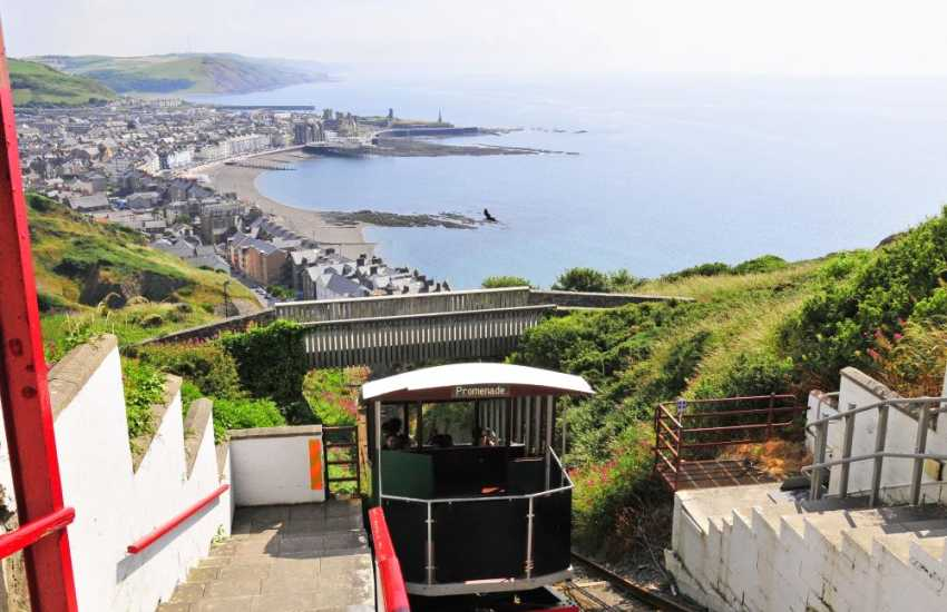 Visit Aberystwyth, a vibrant university town with an elegant promenade, shops, pubs, restaurants and seashore cliff railway