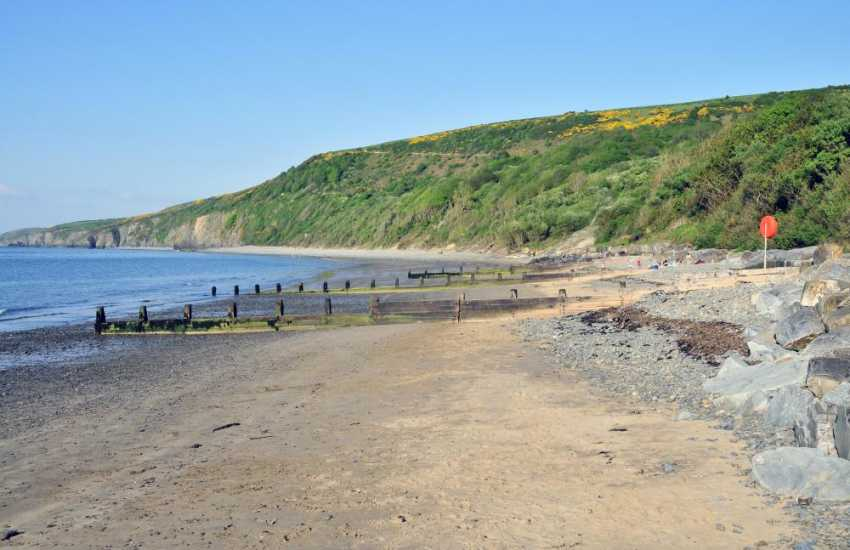 The Wales Coastal Path wends its way along the clifftop from Aberaeron to the sheltered sandy beach of Cei Bach (pictured)