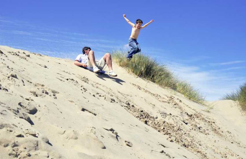 Have loads of fun playing on the miles of dunes at Ynyslas beach