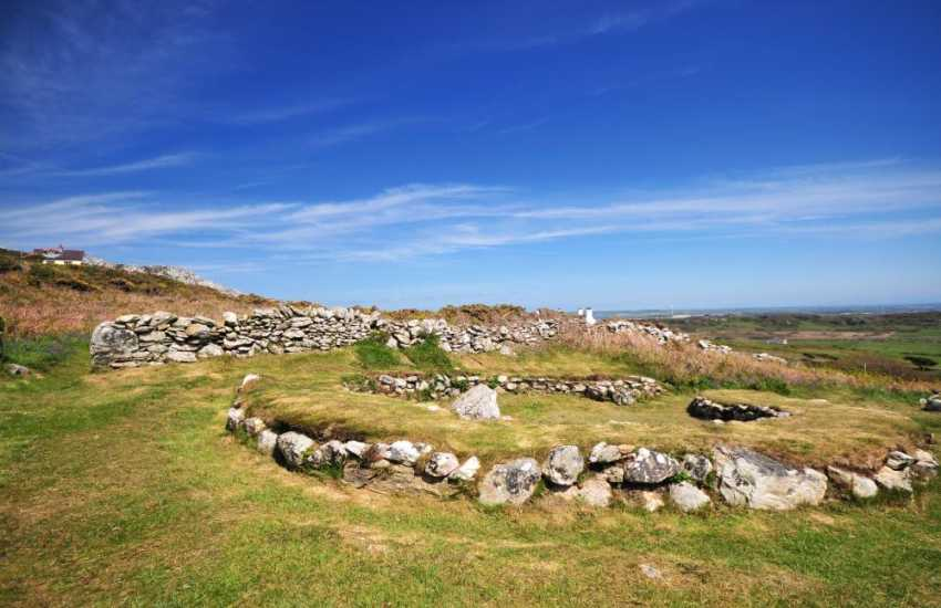 Iron Age settlement at the foot of Holyhead mountain near the car park at South Stack. Worth a visit, as  substantial remains of around 20 circular huts can be seen