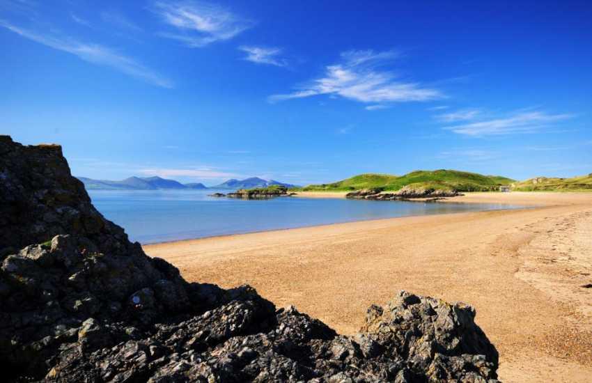 Walk along Newborough beach to reach - Llanddwyn Island