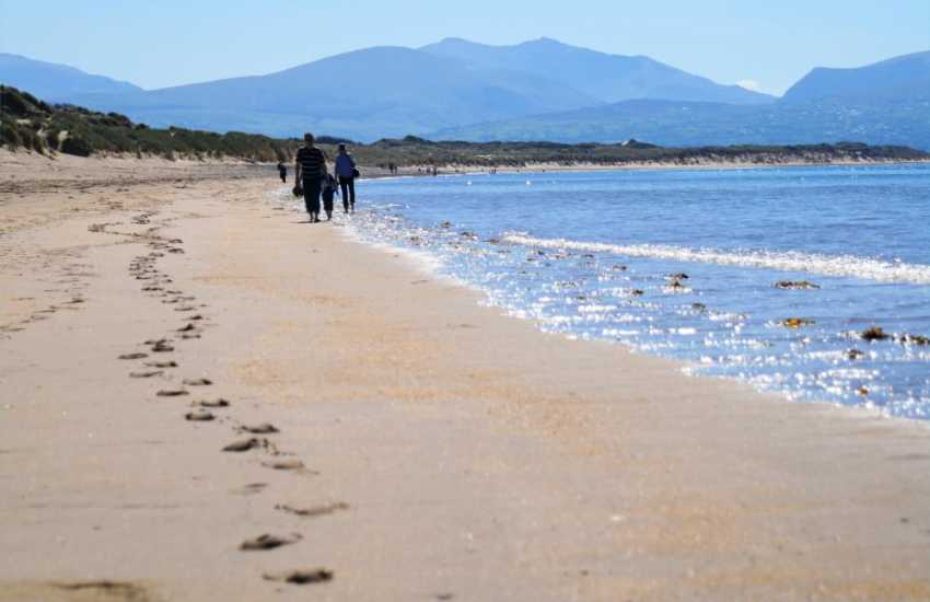 Stroll along the shores on the long sandy beach at Newborough