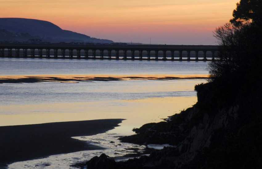 A peaceful sunset over Barmouth Bridge