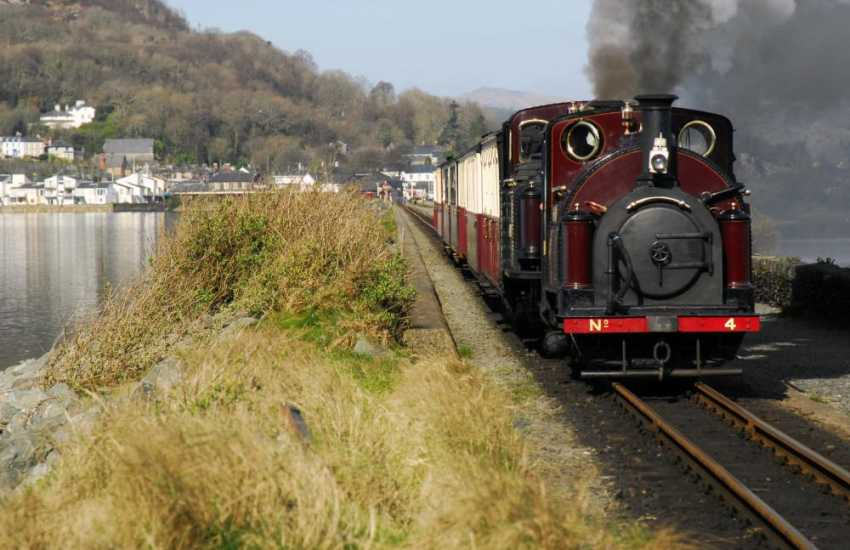 The Ffestiniog Steam railway at Porthmadog - enjoy a run over the embankment with its fine views of the Snowdon Massif and onwards up the wooded Maentwrog Valley