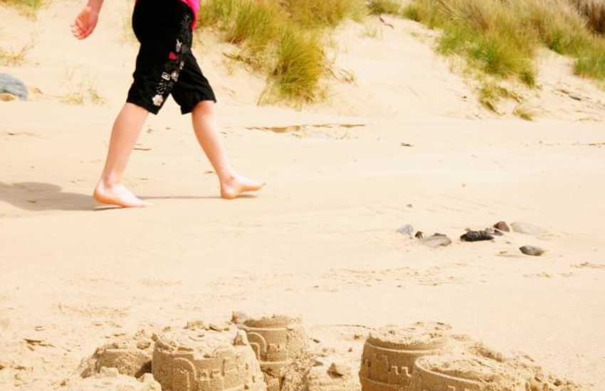 The North Wales coastline is peppered with quiet sandy beaches and dunes to spend the day in