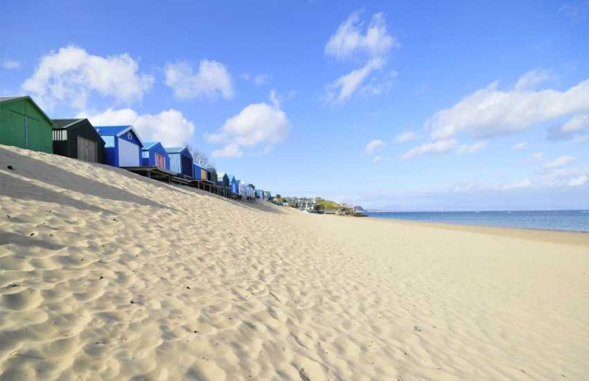 The long sandy beach at Abersoch with its beach huts is a great place to spend the day