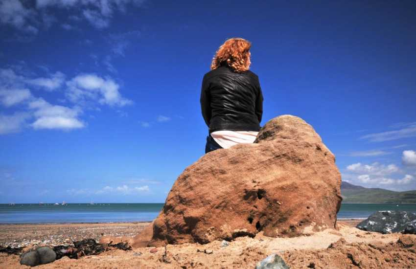 Sit and take in the open expanse of ocean on Morfa Nefyn bay