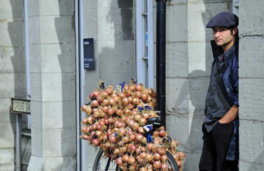 An 'onion seller' on the street in Llanidloes on market day