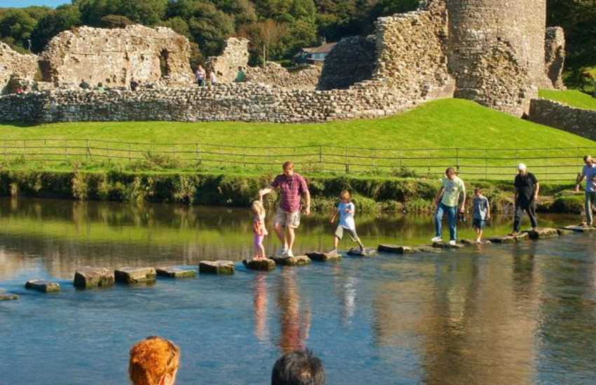 Ogmore Castle sits beside the Ewenny River - walk the 52 stepping stones at low tide over to the picturesque village of Merthyr Mawr.