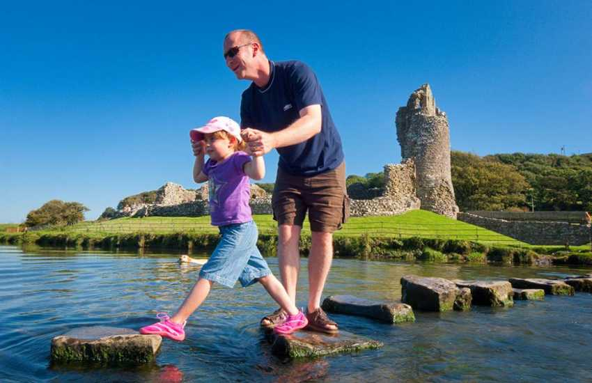 Ogmore Castle with its 52 stepping stones over the ford of Ewenny and Ogmore rivers. Built for a love stricken maiden who lived in the castle and her lover who was across the waters at Merthyr Mawr.