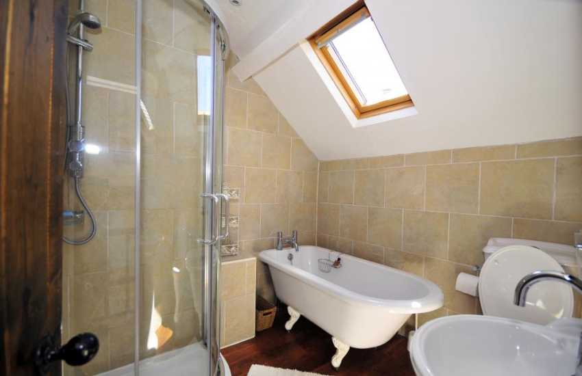 Bathroom on first floor with bath and walk in shower