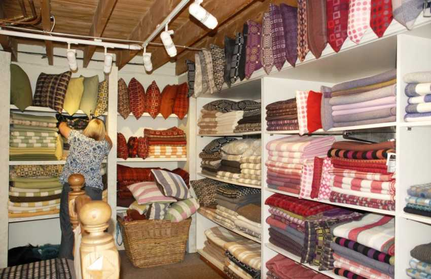 Visit Melin Tregwynt- an 18th century working mill famous for its exclusive Welsh design blankets, throws, cushions and clothing