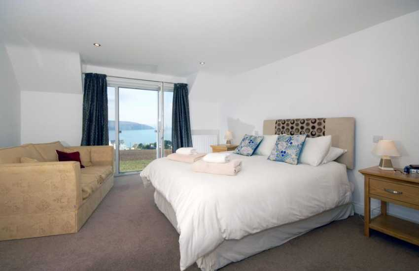 Cardigan holiday home with sea views - king size master bedroom