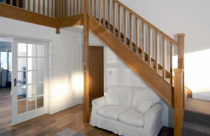 Entrance hall with galleried landing, Oak staircase and striking chandelier
