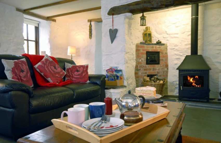 Welsh stone holiday cottage - inglenook fireplace and log burning stove