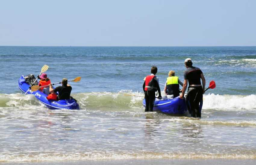 Sea kayaking on the shores of nearby Aberbach and Abermawr beaches - TYF Activities in St Davids have a wide range of water sports on offer