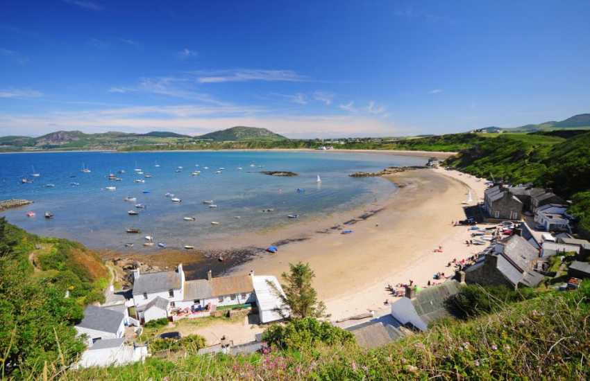 Porthdinllaen the beach is lovely and sandy with the famous 'Ty Coch' pub on the water's edge - dip your feet in the water while enjoying traditional ales